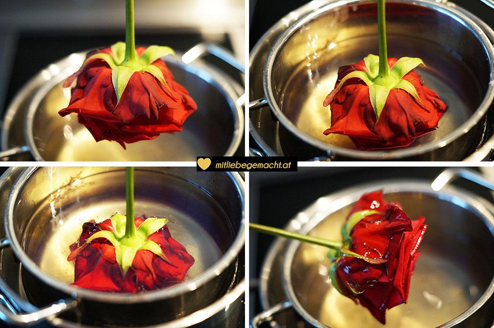 Kerzenreste verwerten - Rosen vorsichtig in das Wachs tauchen und abschütteln